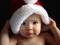 عکس بچه با کلاه بابا نوئل