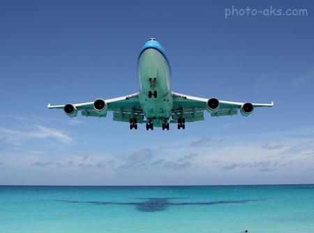 عکس زیبای فرود هواپیما boeing 747 ocean
