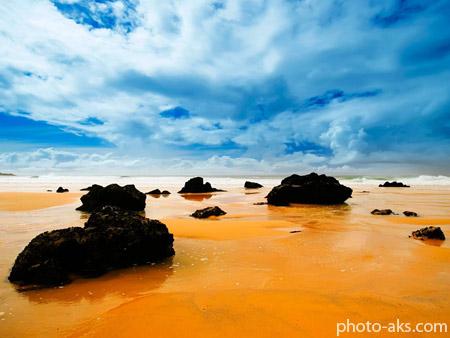 پوستر ساحل زیبای سنگی rock in beach