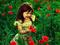 دختر بچه زیبا در میان گلها