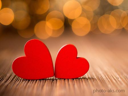 عکس عاشقانه و خوشگل از دو قلب قرمز چوبی