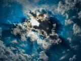 عکس خورشید پشت ابر